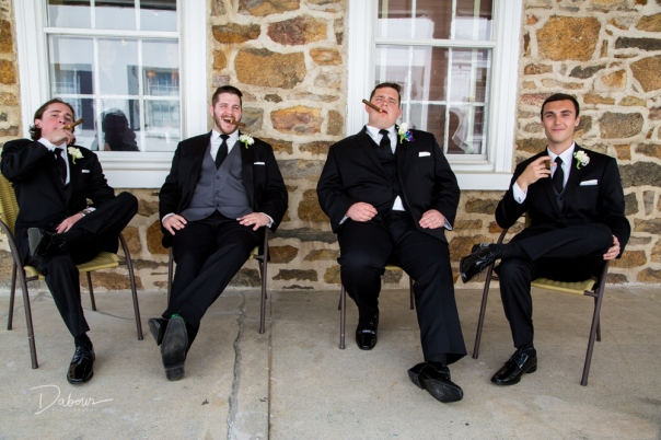 Grooms men relax before the ceremony
